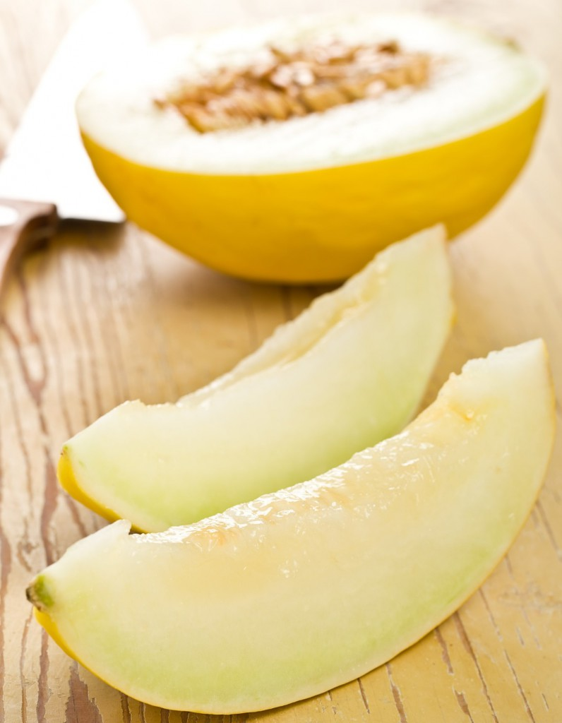 cut honeydew melon on kitchen table